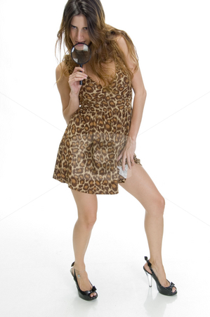 Posing woman holding lens stock photo, Posing woman holding magnifying glass by Imagery Majestic