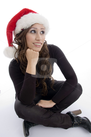 Sitting woman wearing christmas hat stock photo, Sitting woman wearing christmas hat on an isolated background by Imagery Majestic