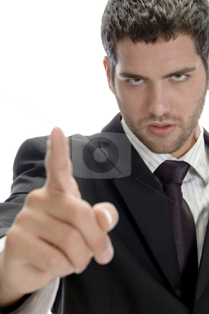 Portrait of young businessman stock photo, Portrait of young businessman pointing by Imagery Majestic
