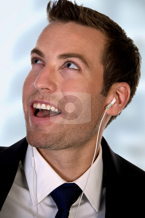 Portrait of businessman listening music stock photo, Portrait of businessman listening music on an isolated white background by Imagery Majestic