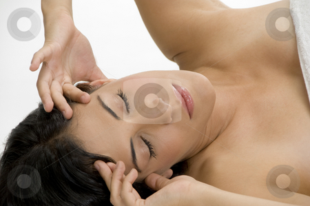 Female suffering from headache stock photo, Female suffering from headache on an isolated white background by Imagery Majestic