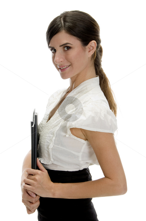 Side view of smiling lady with files stock photo, Side view of smiling lady with files on an isolated background by Imagery Majestic