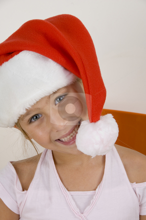Smiling little girl wearing christmas hat stock photo, Smiling cute little girl wearing christmas hat by Imagery Majestic