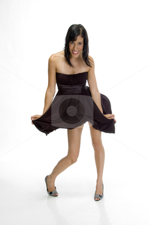 Sexy lady adjusting her cloth stock photo, Sexy lady adjusting her cloth over white by Imagery Majestic