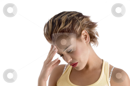 Woman with a headache stock photo, Woman with a headache on an isolated background by Imagery Majestic