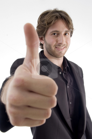 Young male wishing goodluck stock photo, Young male wishing goodluck on an isolated white background by Imagery Majestic