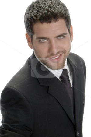 Smiling businessman looking to camera stock photo, Smiling businessman looking to camera against white background by Imagery Majestic