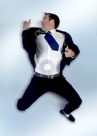Businessman jumping in the air  stock photo, Businessman jumping in the air on an abstract  background by Imagery Majestic