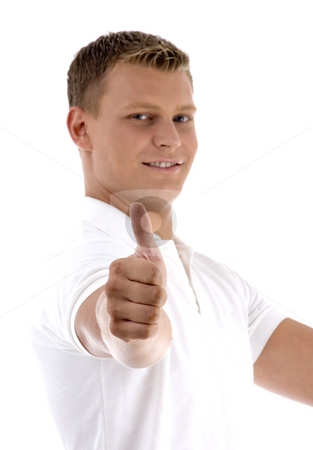 Portrait of young guy gesturing thumbs up   stock photo, Portrait of young guy gesturing thumbs up  with white background by Imagery Majestic