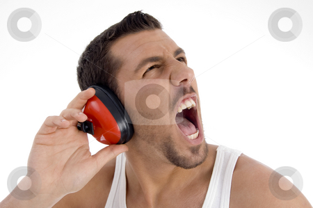 Young guy enjoying rock music with full volume stock photo, Young guy enjoying rock music with full volume against white background by Imagery Majestic