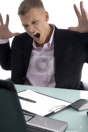 Frustrated young manager stock photo, Frustrated young manager with white background by Imagery Majestic
