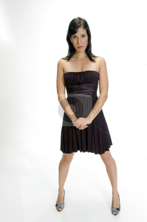 Cool stylish woman posing stock photo, Cool stylish woman posing on an isolated white background by Imagery Majestic