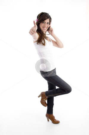 Standing woman with cell phone wishing good luck stock photo, Standing woman with cell phone wishing good luck with white background by Imagery Majestic