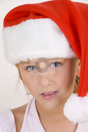 Smiling little girl wearing christmas hat stock photo, Smiling little girl wearing christmas hat by Imagery Majestic