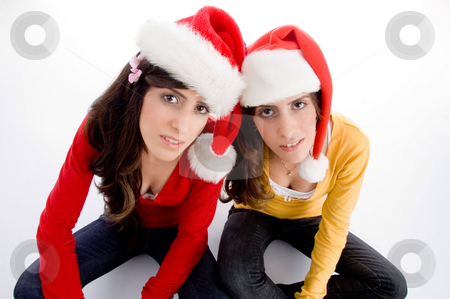 Sitting females with christmas hat stock photo, Sitting females with christmas hat on an isolated background by Imagery Majestic