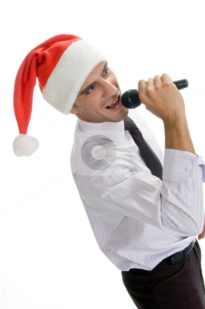 Male singing into karaoke stock photo, Male singing into karaoke on an isolated background by Imagery Majestic