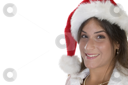 Smiling lady with santacap stock photo, Smiling lady with santacap on an isolated background by Imagery Majestic