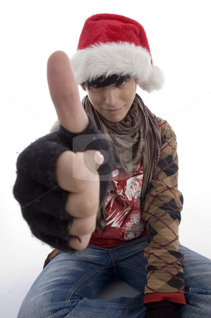 Young boy wearing christmas hat showing thumb stock photo, Young boy wearing christmas hat showing thumb on an isolated white background by Imagery Majestic