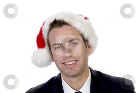 Smart businessman  with santacap stock photo, Smart businessman  with santacap on an isolated white background by Imagery Majestic