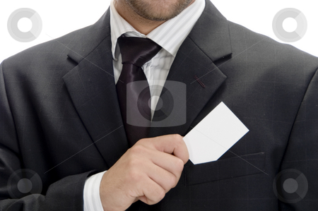 Young businessman saving his visiting card stock photo, Young businessman saving his visiting card isolated on white background by Imagery Majestic