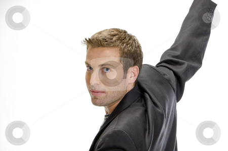 Handsome male model posing in style stock photo, Handsome male model posing in style over white by Imagery Majestic