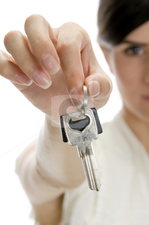 Woman showing keys stock photo, Woman showing keys on an isolated white background by Imagery Majestic
