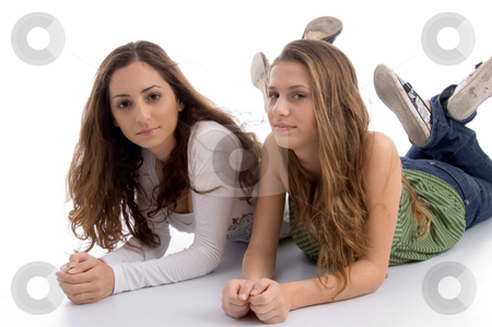 Two young friends posing at camera stock photo, Two young friends posing at camera on an isolated white background by Imagery Majestic
