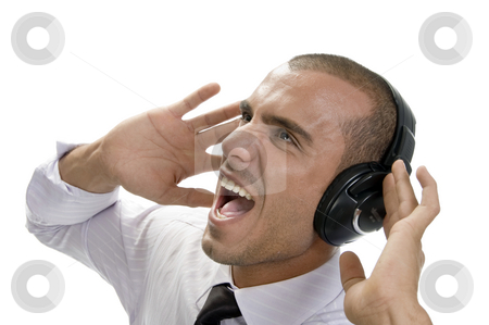 Shouting businessman with headphone stock photo, Shouting businessman with headphone on an isolated background by Imagery Majestic