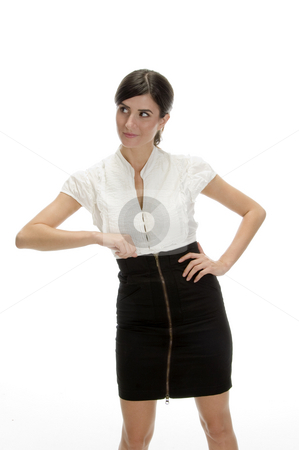 Young lady showing offering gesture stock photo, Young lady showing offering gesture against white background by Imagery Majestic