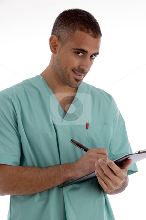 Doctor writing on notepad stock photo, Doctor writing on notepad with white background by Imagery Majestic
