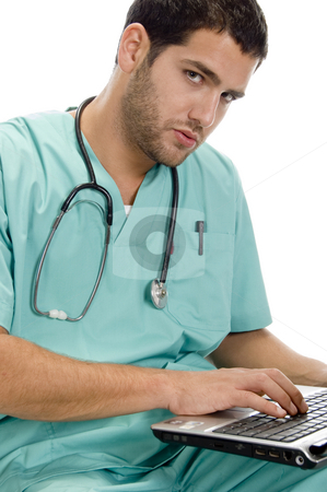 Doctor with laptop and stethoscope stock photo, Doctor with laptop and stethoscope on an isolated white background by Imagery Majestic
