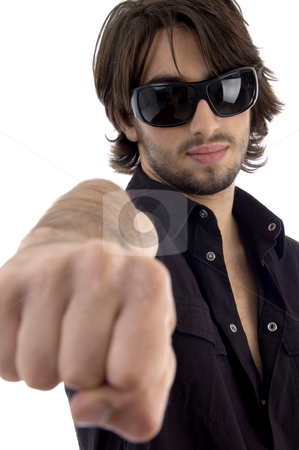 Young male showing punch stock photo, Young male showing punch on an isolated white background by Imagery Majestic