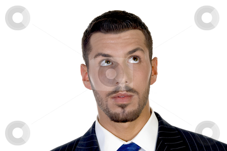 Executive looking upward stock photo, Executive looking upward on an isolated background by Imagery Majestic