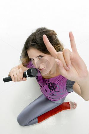 Female with karaoke showing hand gesture stock photo, Female with karaoke showing hand gesture on an isolated white background by Imagery Majestic