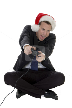 Happy businessman playing video game stock photo, Happy businessman playing video game on white background by Imagery Majestic