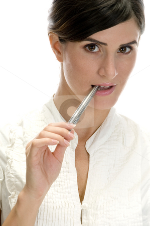 Lady with pen in her mouth stock photo, Lady with pen in her mouth on an isolated white background by Imagery Majestic