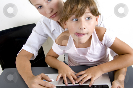 American mother with daughter stock photo, American mother with daughter working on laptop by Imagery Majestic