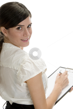 Smiling lady with pen and paper in writing pad stock photo, Smiling lady with pen and paper in writing pad on an isolated background by Imagery Majestic