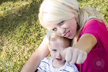 Mother with thumbs up hand gesture stock photo, Mother holding child and with thumbs up hand gesture by Imagery Majestic