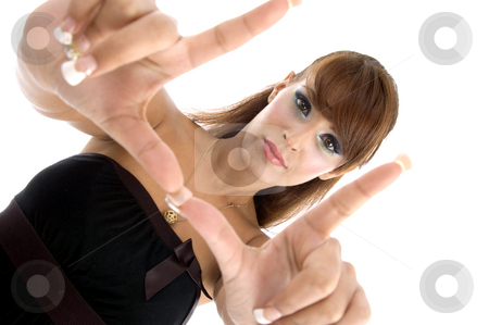 Gorgeous woman showing hand gesture stock photo, Gorgeous woman showing hand gesture with white background by Imagery Majestic