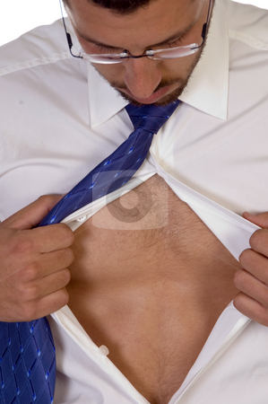 Male looking into his shirt stock photo, Male looking into his shirt against white background by Imagery Majestic