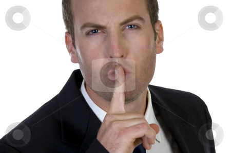 Portrait of businessman with his finger on his lips stock photo, Portrait of businessman with his finger on his lips on white background by Imagery Majestic