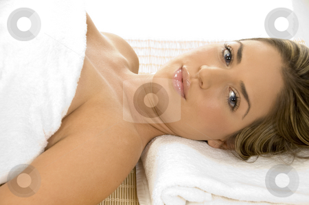Relaxing lady looking you stock photo, Relaxing lady in towel looking you by Imagery Majestic