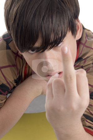 Young boy showing you finger stock photo, Young boy showing you finger on an isolated white background by Imagery Majestic