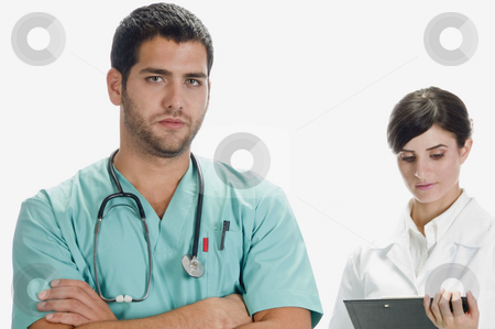 Handsome doctor and pretty nurse stock photo, Handsome doctor and pretty nurse against white background by Imagery Majestic
