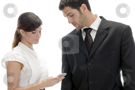 Woman dialing numbers to her mobile stock photo, Woman dialing numbers to her mobile and man looking at her Cell phone by Imagery Majestic