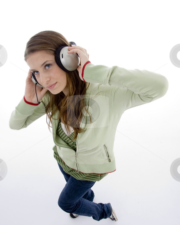 Woman listening to headset enjoying stock photo, Woman listening to headset enjoying with white background by Imagery Majestic