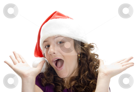 Female with santa cap stock photo, Female with santa cap against white background by Imagery Majestic