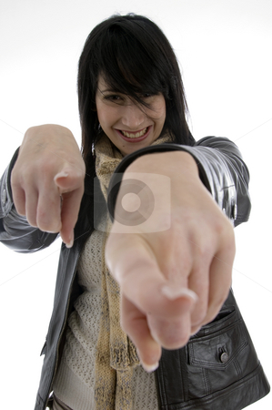 Cheerful woman pointing towards camera stock photo, Cheerful woman pointing towards camera on an isolated white background by Imagery Majestic