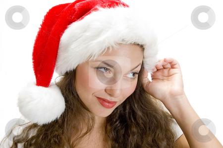 Female holding santa cap stock photo, Pretty female holding santa cap by Imagery Majestic